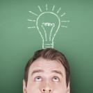 man looking at drawn light bulb