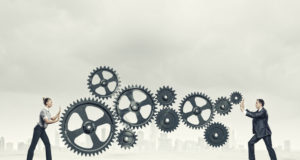 Business people and cogs - Leadership Space