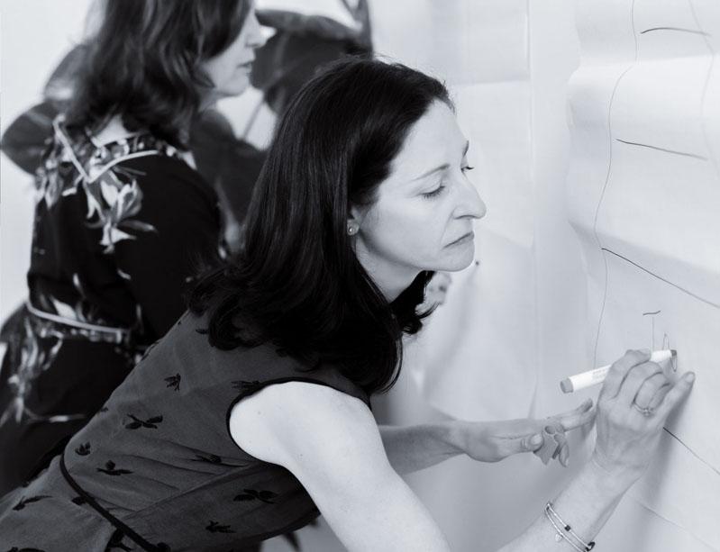 Elise Sernik writing on whiteboard